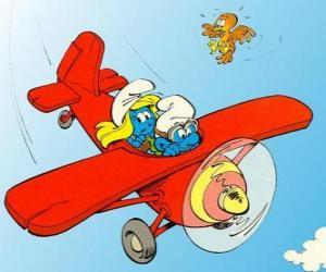 Puzle Šmoula a Šmoulinku létání červené letadlo
