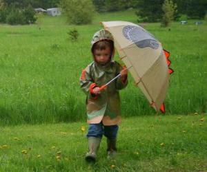 Puzle Boy s jeho deštníkem a pláštěnka v rámci jarní déšť