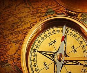 Puzle Buzolou a mapou některé základní příslušenství pro průzkumníky a dobrodruhy