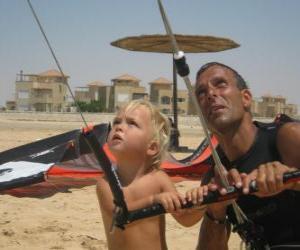 Puzle Dítě dělá pouštění draka se svým otcem