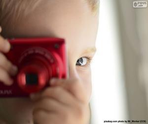 Puzle Dítě s fotografickou kamerou