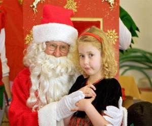 Puzle Dívka hovoří do Santa Claus sedí na klíně