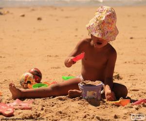 Puzle Dívka hraje na pláži