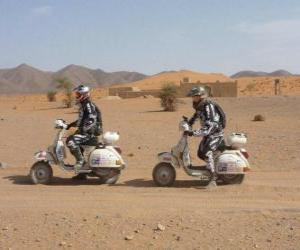 Puzle Dva dobrodruzi na motorce
