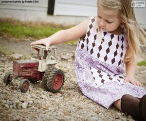 Puzle Holka, co si hraje s traktorem