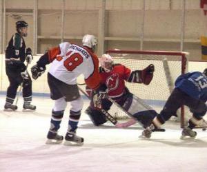 Puzle Hráče a brankáře v ledním hokeji utkání