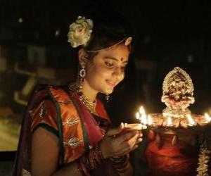 Puzle Klečící žena s olejovou lampu do svých rukou oslavy Diwali