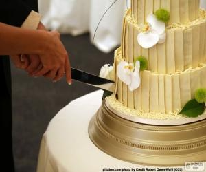 Puzle Nevěsta a ženich řezání svatební dort