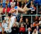 Sportovec dělá skok o tyči