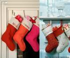 Několik visí vánoční punčochy plné dárků