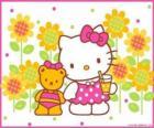 Hello Kitty s pitím v přírodě se svým plyšovým medvědem Tiny Chum