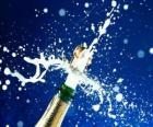 Uncorking láhev šampaňského oslavíme Nový rok