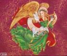 Anděl hrající na harfu oslavit Vánoce
