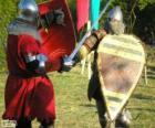 Dva vojáci, kteří bojují s meči a štíty