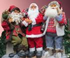 Tři panenky Santa Claus