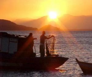 Puzle Rybáři při západu slunce