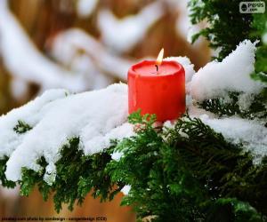 Puzle Svíčka červená na větvi