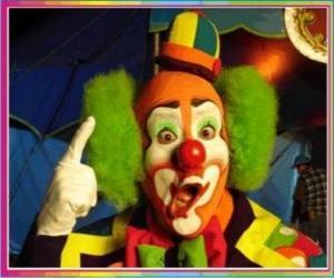 Puzle Tvář klauna s parukou, kloboukem a velikány nosu a úst