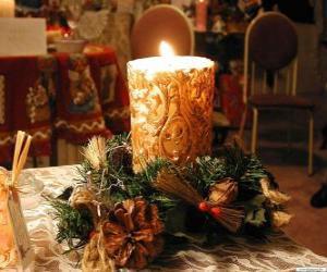 Puzle Zapálil svíčku jako ozdobu ozdobené větvičky jmelí a jedlové