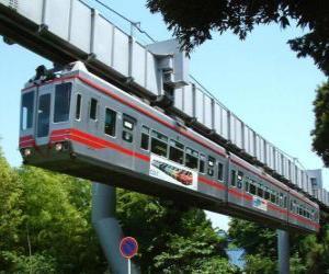 Puzle Zavěšené monorail. Cestující s výhledem pouťové monorail